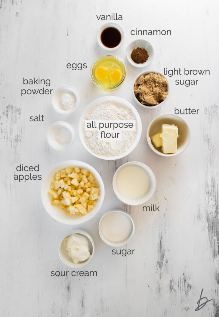 apple crumble muffins ingredients in bowl labeled with text