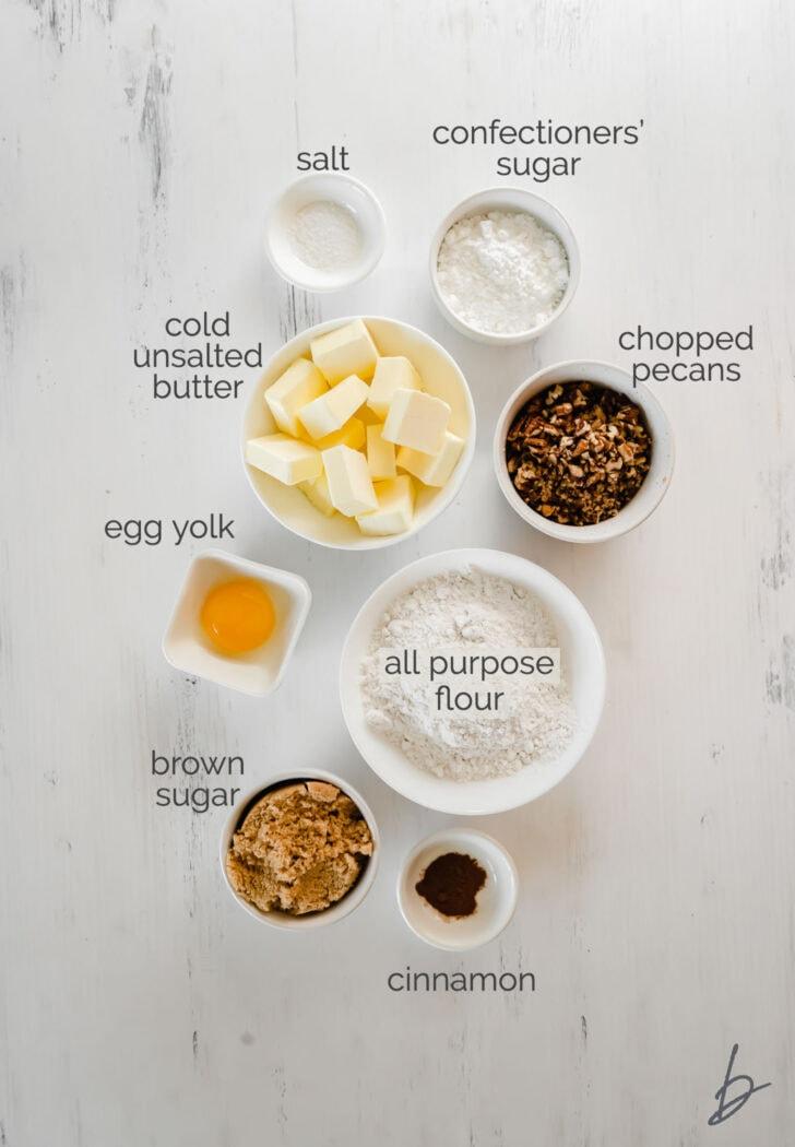 pecan sandies cookies ingredients in bowls labeled with text