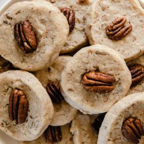 plate of pecan sandies garnished with pecan halves
