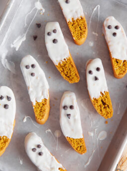 pumpkin biscotti with white chocolate dip and mini chocolate chip face to look like ghosts