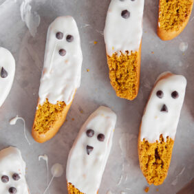 white chocolate dipped pumpkin biscotti to look like ghosts