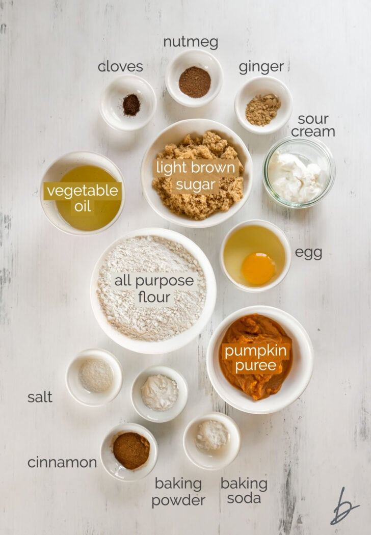 pumpkin coffee cake ingredients in bowls labeled with text