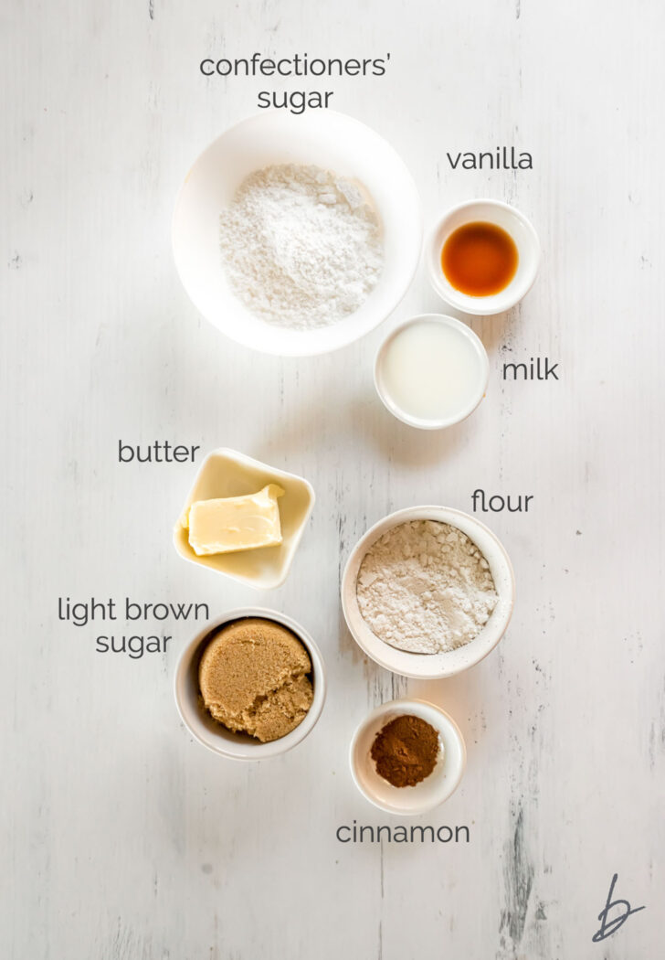 streusel and icing ingredients in bowls labeled with text