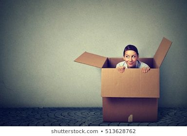 young-woman-coming-out-box-260nw-513628762-8929825
