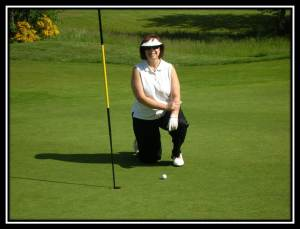 What Will Your Retirement Look Like? photo  female Golfer, closest to the pin.