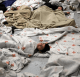 Child detainees sleep in a holding cell at a US Customs and Border Protection processing facility (Reuters/Eric Gay/Pool)