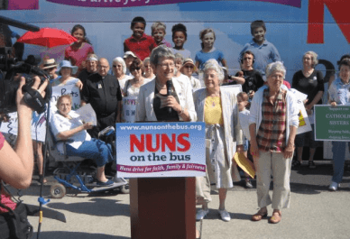 Sr. Simone Campbell and fellow nuns speak in Cleveland, Ohio, during the 2012 Nuns on the Bus tour.