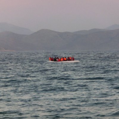 A rubber boat carrying around 50 migrants and refugees arrives from Bodrum in Turkey to the Greek island of Kos in the early hours of the morning. [SOURCE: Christopher Jahn/IFRC]