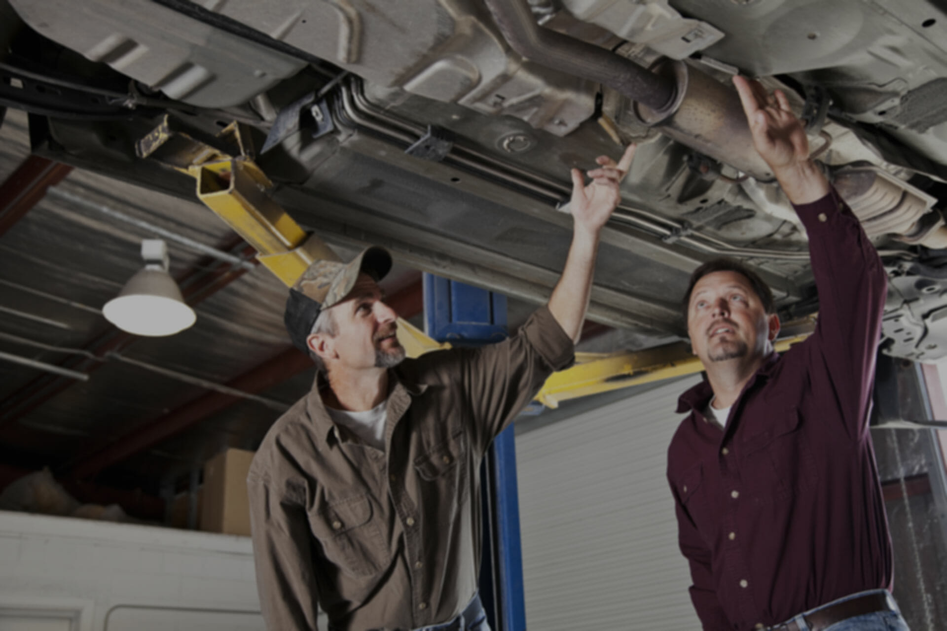 mechanic talking with happy customer after SEO results