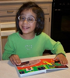 Photo of child enjoying a Seedlings book