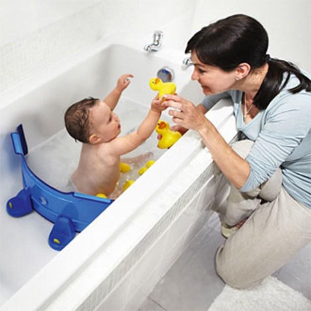 Разделитель для ванны, не пропускающий воду. Можно регулировать размер ванночки для ребенка и экономить воду