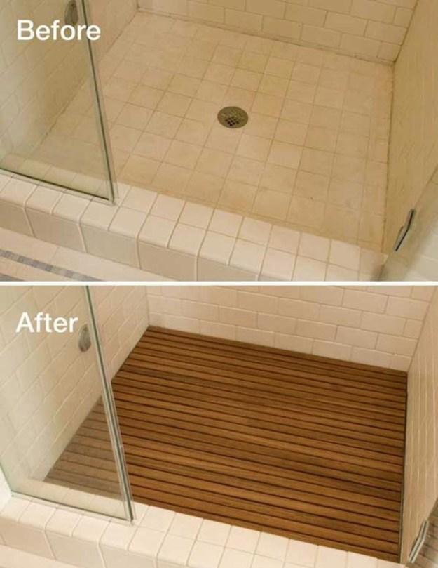 Если вместо ванны у вас душевая кабина, положите вниз деревянный настил, он полностью меняет вид душа