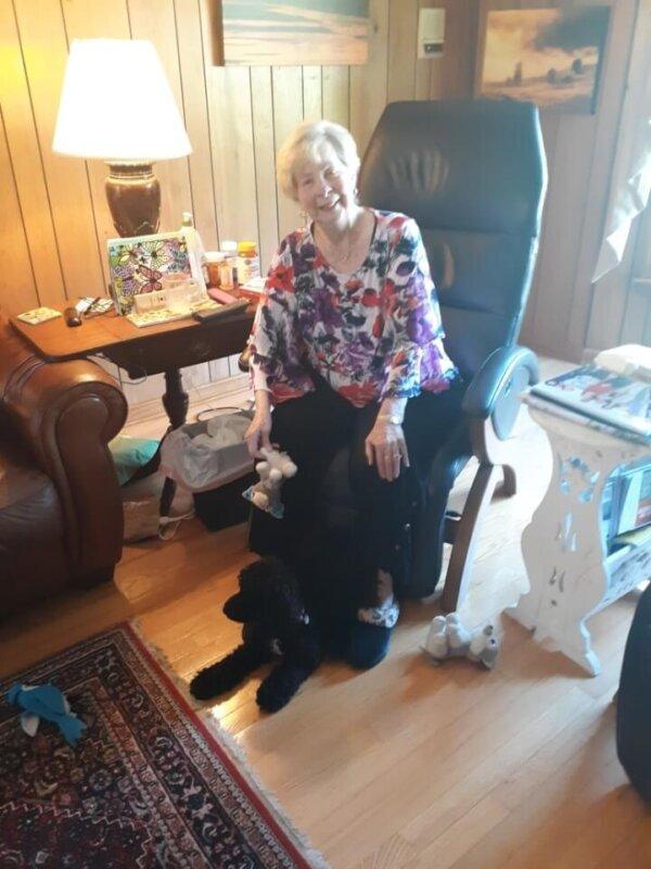 Elderly Woman and Black Puppy