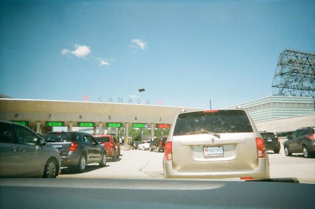 Heading back over the border. Taken with disposable camera.