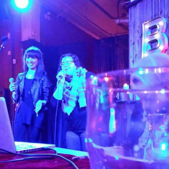 Kristin and Trish singing karaoke at The Baltimore House. Photo by The Eye Of Faith