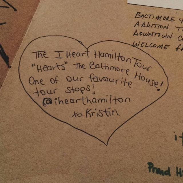 Kristin writing in The Baltimore House's sketchbook, December 2011
