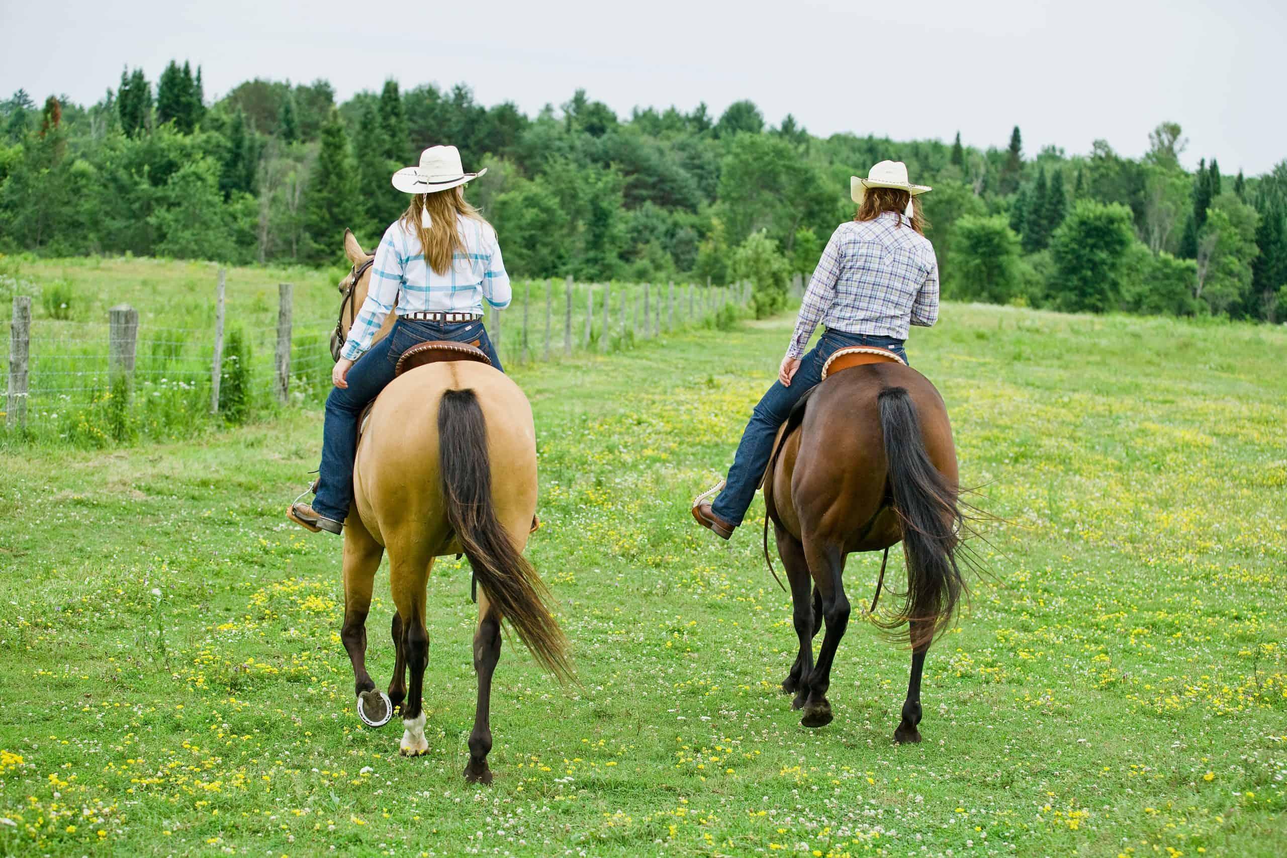 Two women riding horseback