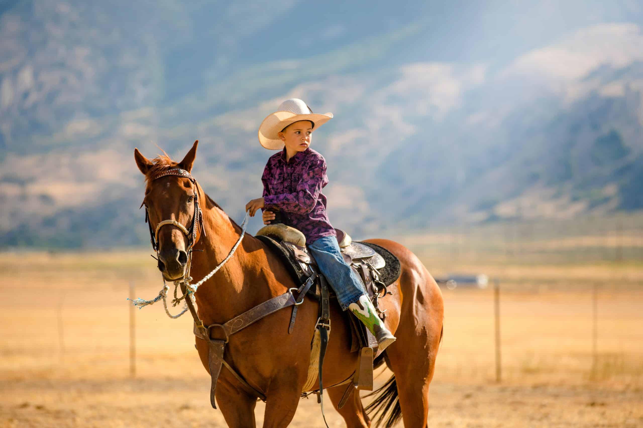 A long cowboy rides his horse in Utah, USA