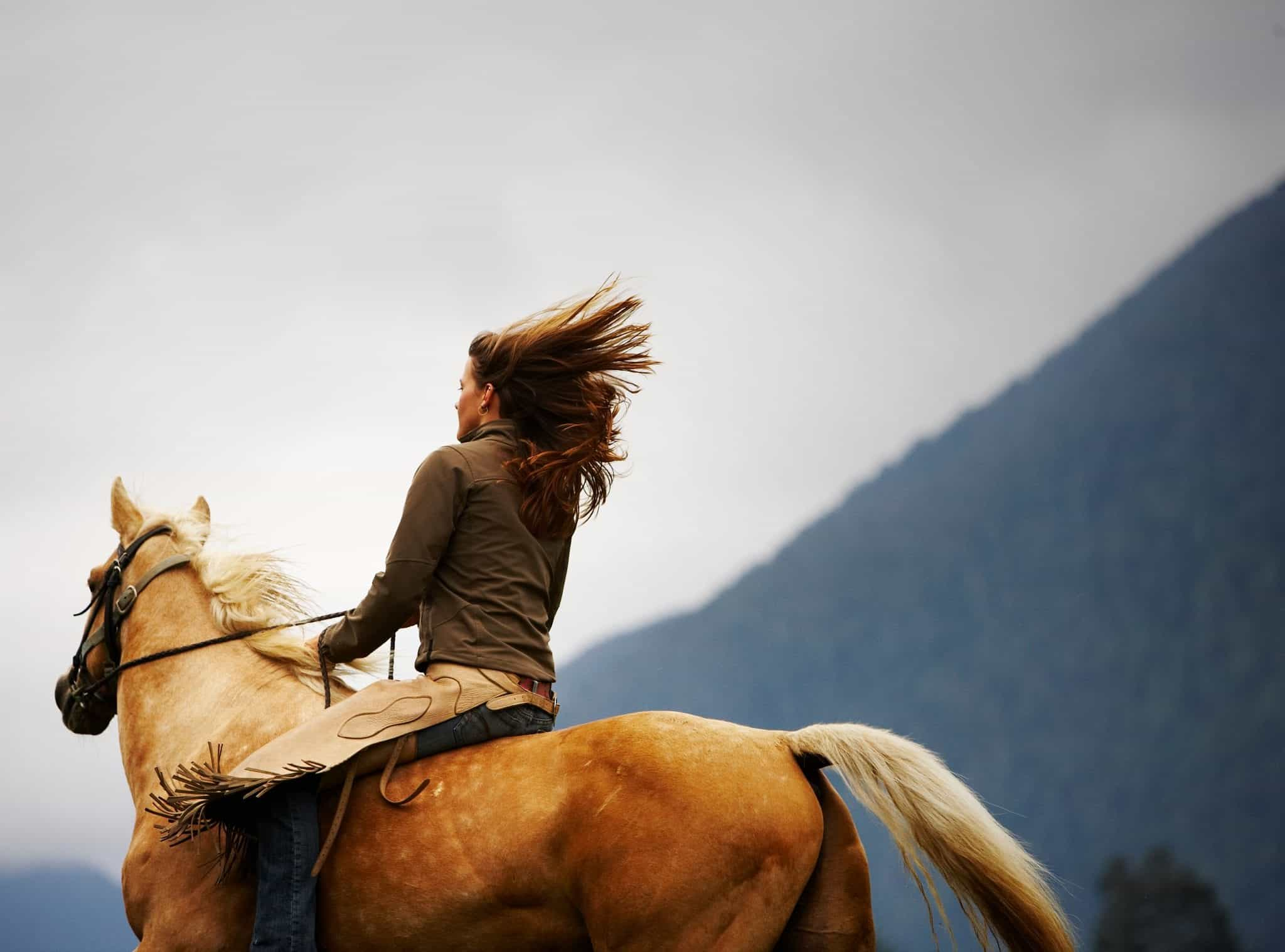 Woman riding horse bareback