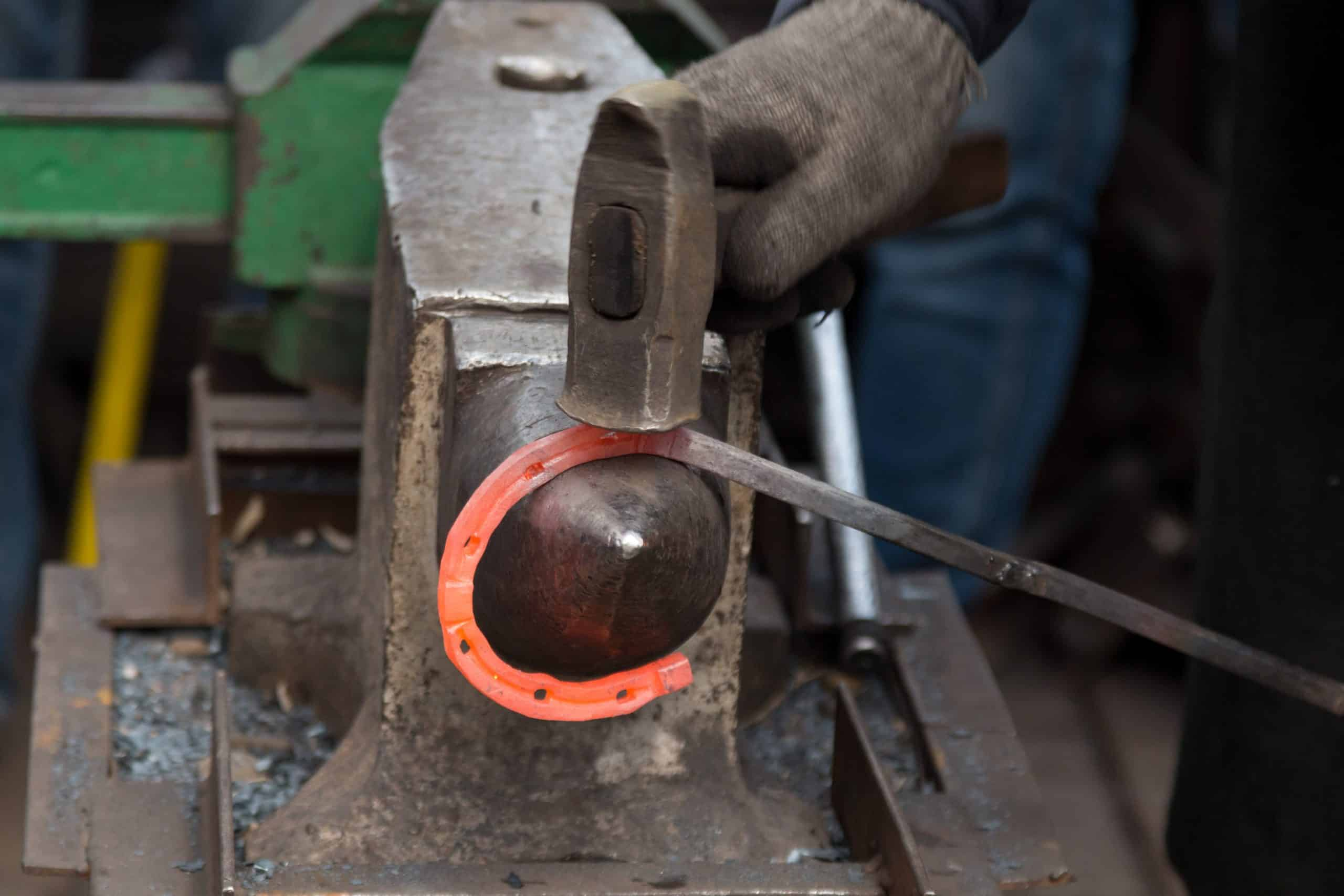 Making the horseshoe from heated red rod