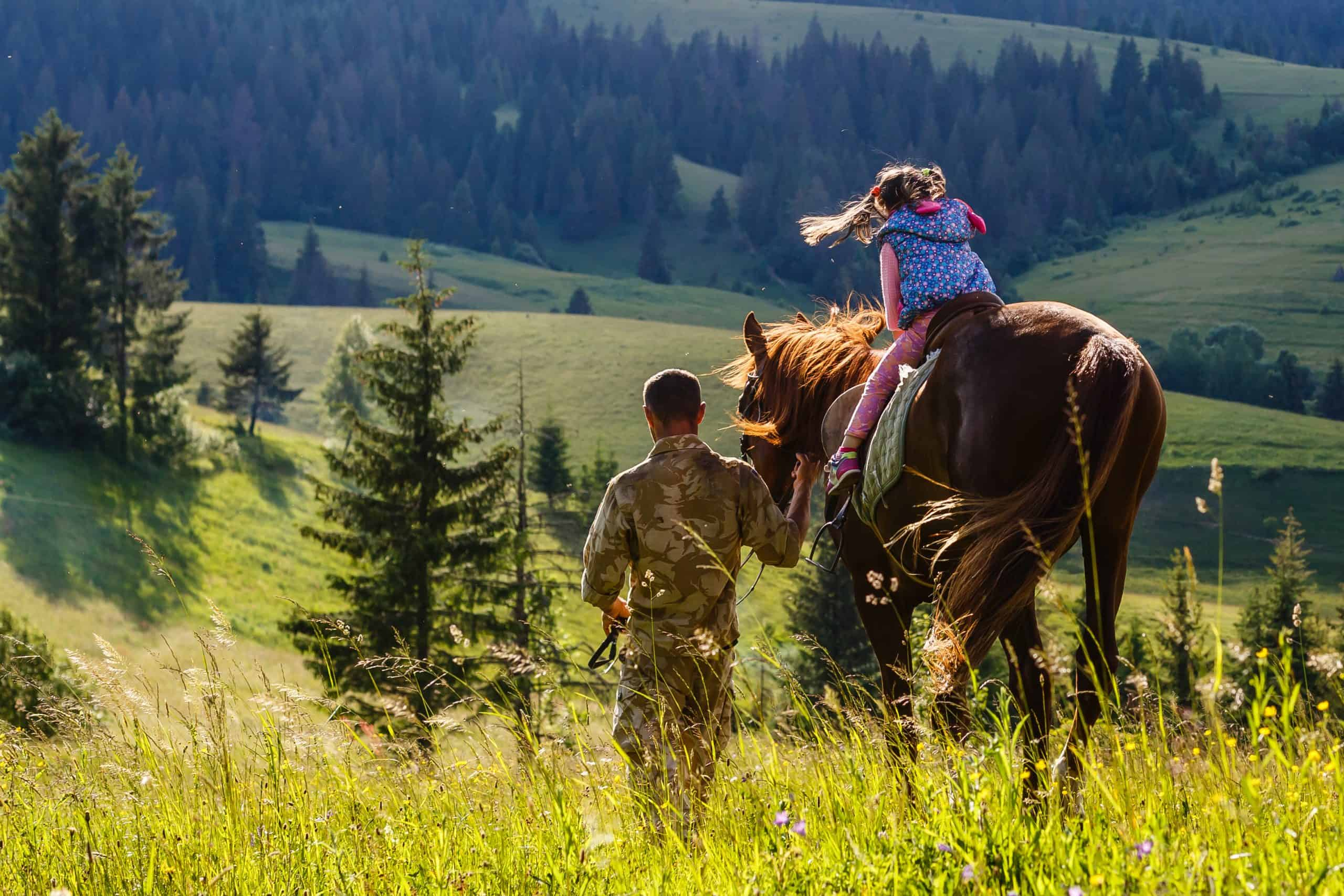 teaches girl to ride a horse. Lesson with Riding Instructor.