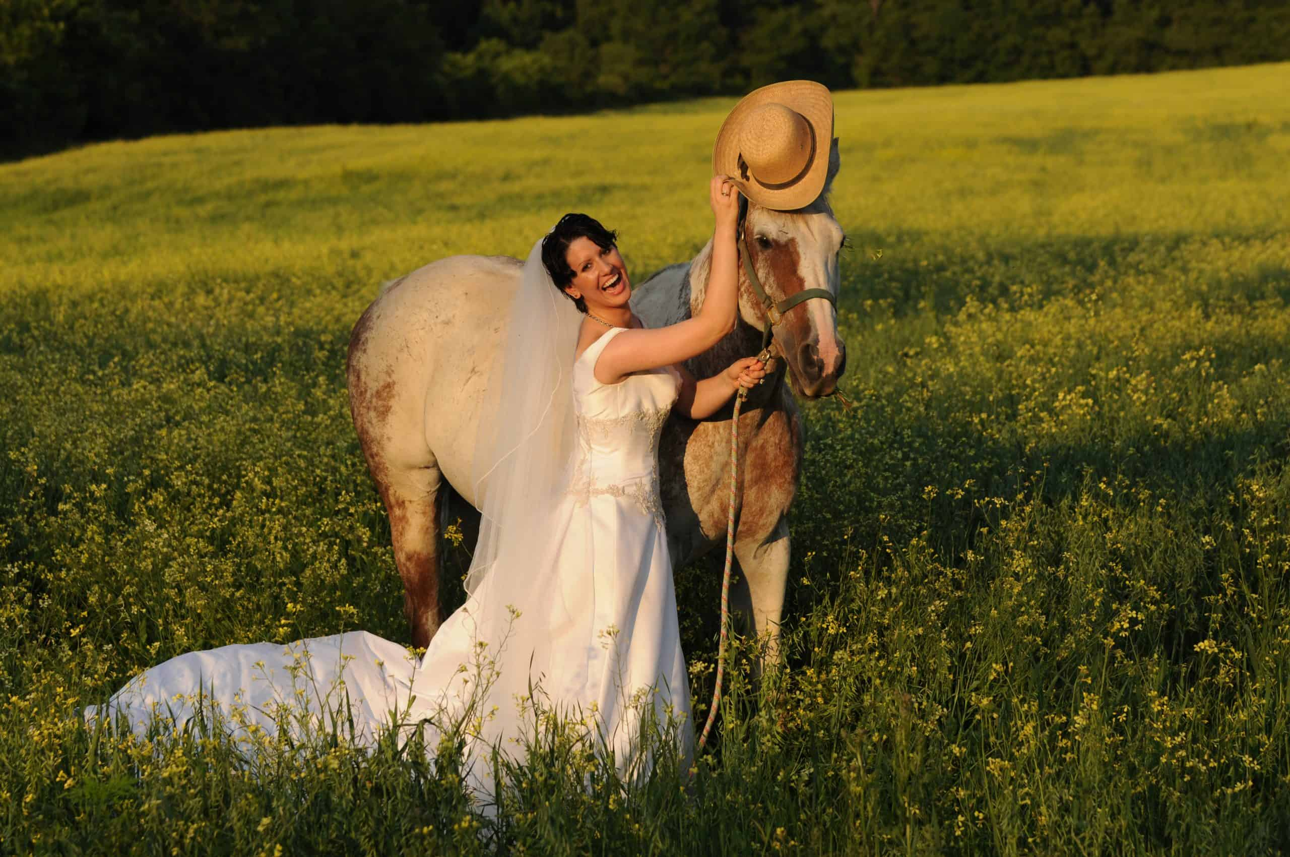 Bride in Wedding Dress with horse at a farm