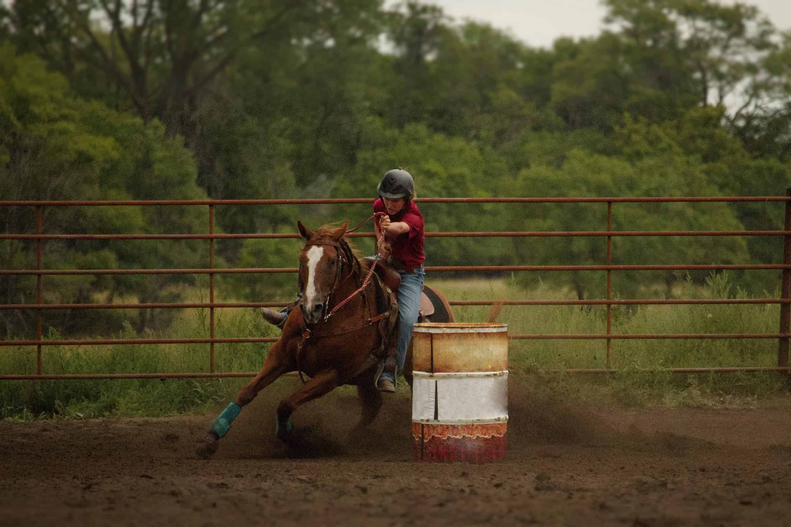 Outdoor barrel racing in sun and shade jackpot rodeo horse event