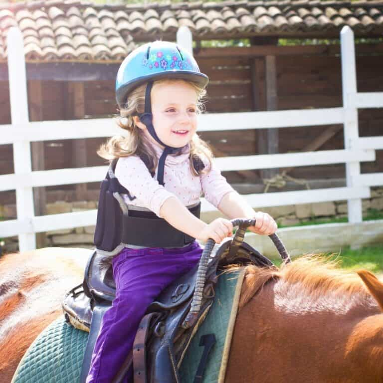 Girl in brace riding horse