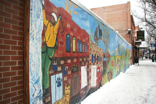 Only in downtown Bozeman does the main street mural feature an ice climber