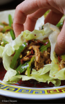 Paleo Chinese Spicy Pepper Pork Lettuce Wraps. Thin sliced pepper pork wrapped in iced crunchy lettuce wraps in Chinese spicy chili sauce. Paleo Chinese food. Paleo Asian food. IHeartUmami.com