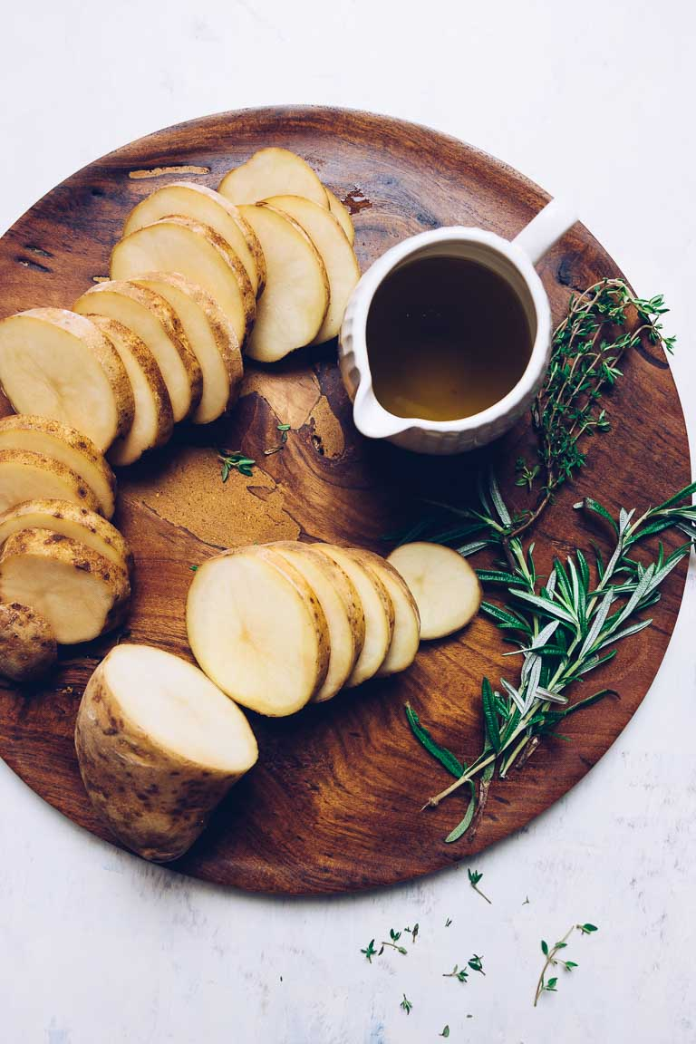 Whole30 Oven Roasted Crispy Potatoes recipe with rosemary and thyme infused oil.