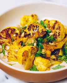 Paleo Roasted Cauliflower Recipe with tahini-lemon sauce from I Heart Umami.