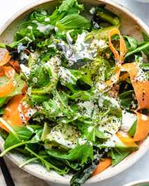 Asian Green Tatsoi salad with carrots and cucumber in ranch yogurt dressing