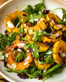 A plate shows baked squash delicata recipe