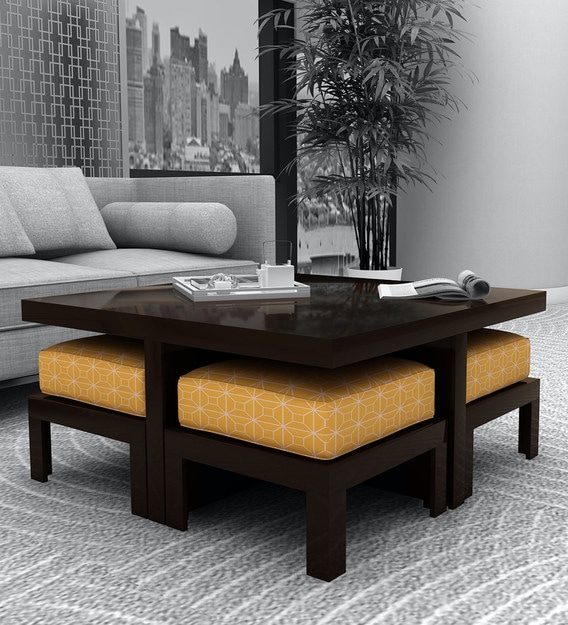 trendy coffee table with 4 stools in ochre colour