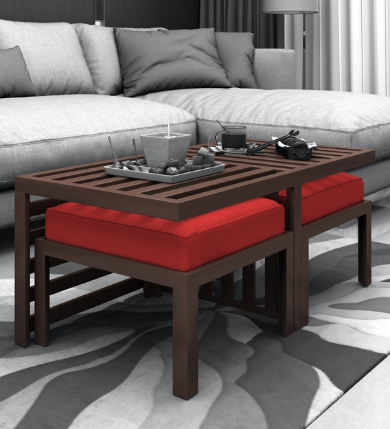 trendy coffee table with 2 red cushioned stools in brown colour