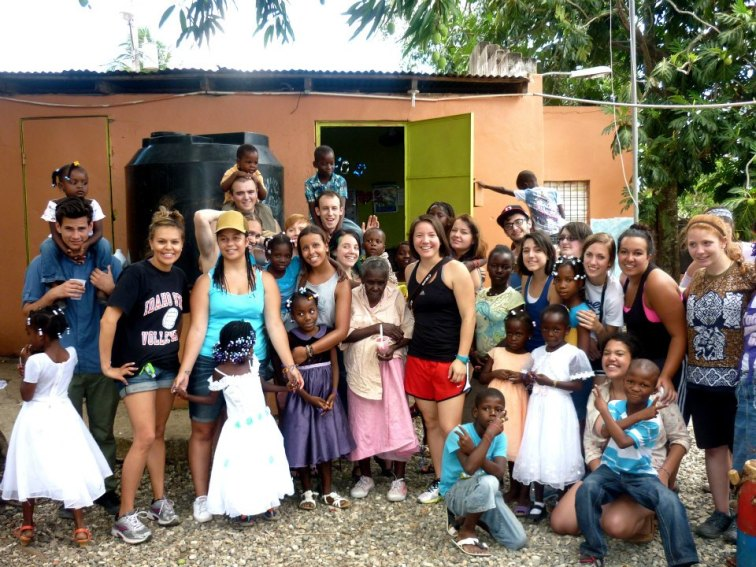 US students from Western Washington University Fairhaven College meet on their study abroad trip to the Dominican Republic Haitian kids at school MUDHA in Palmarejo.
