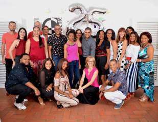 Team of IIC Spanish School in the Dominican Republic groups for a picture to celebrate the school's 25th anniversary.