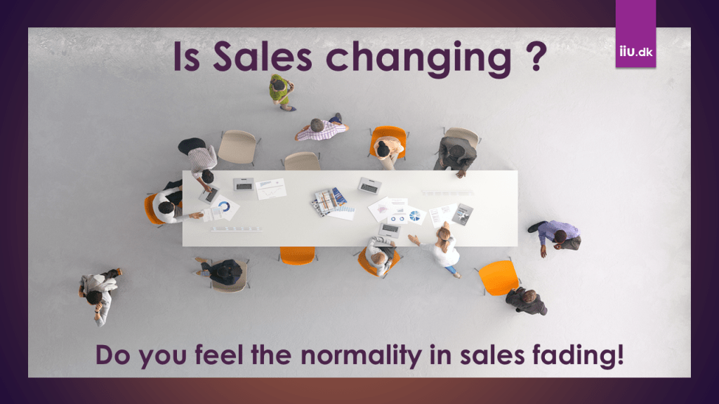 People around a Desk working frantic as Sales are changing.