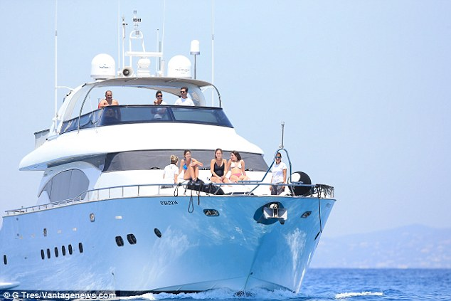 That's the way to do it: The couple have been living the life of luxury aboard a yacht