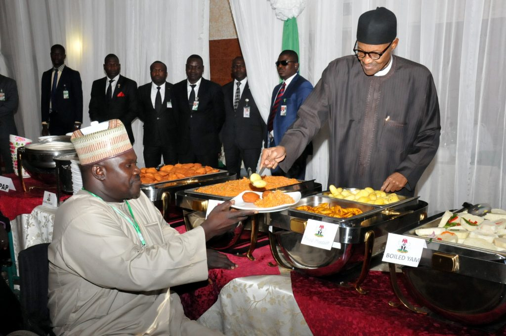 PIC 19.  PRESIDENET MUHAMMADU BUHARI (R) SERVING  FOOD TO THE PRESIDENT PARASOCCER  FEDERATION,  ALHAJI  MUSBAHU  DIDI, DURING BREAKING OF RAMADAN FAST WITH INTERNALLY DISPLACED PERSONS (IDPs),   ARTISANS AND OTHER NIGERIANS AT THE PRESIDENTIAL VILLA ABUJA ON MONDAY (4/7/16) 4820/04/07/16/ICE/NAN