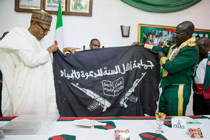 President Buhari receiving Flag  - IJEBULOADED