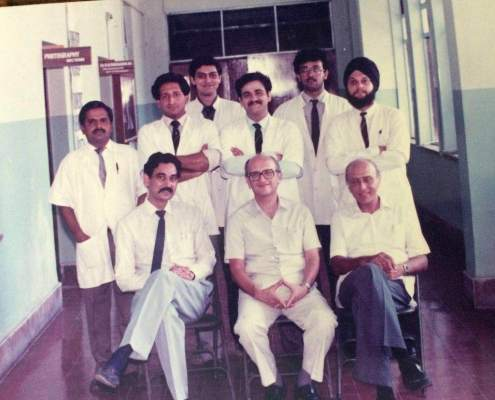 1989, Orthopaedic Unit at JJ Hospital. Dr. Johari is sitting on the left with his teachers, Dr. J.C. Taraporvala (centre) and Dr. P.D. Hakim (right). Behind them are the 3 registrars - on the right Randip Bindra, centre Dr. Gautam Chakraborty and on his right Dr. Sanjay Mehta. All 3 registrars settled outside India
