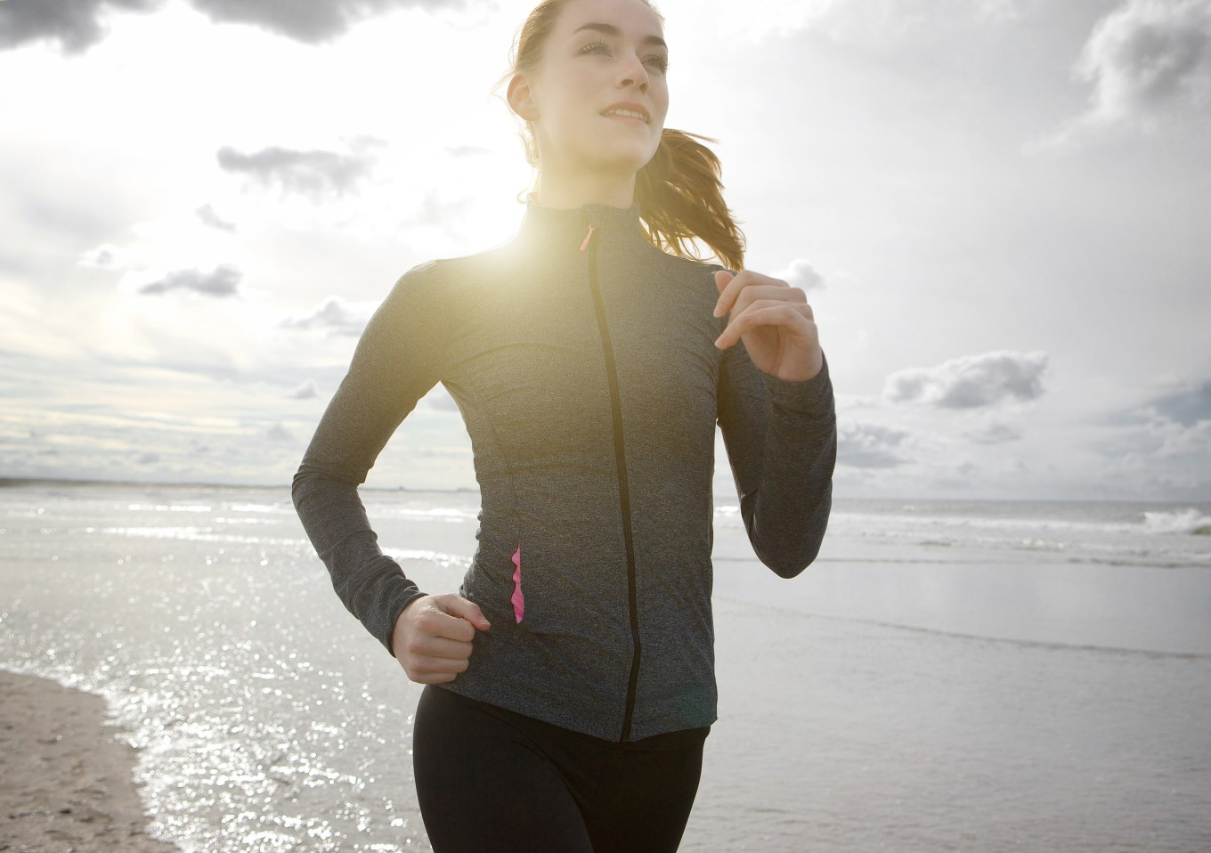 Woman jogging outdoors by the beach