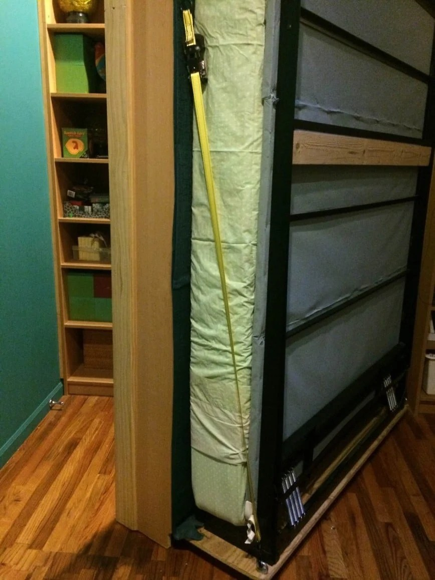 The Center Bookcases Are Mounted On A Piece Of Plywood On Wheels With The Murphy  Bed Attached To The Plywood.