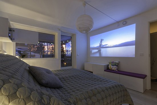 Enjoy a movie night in your bedroom with a home cinema nightstand