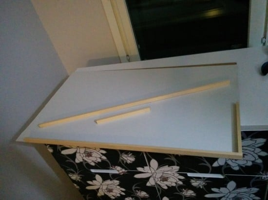Add a wooden backing to the frame