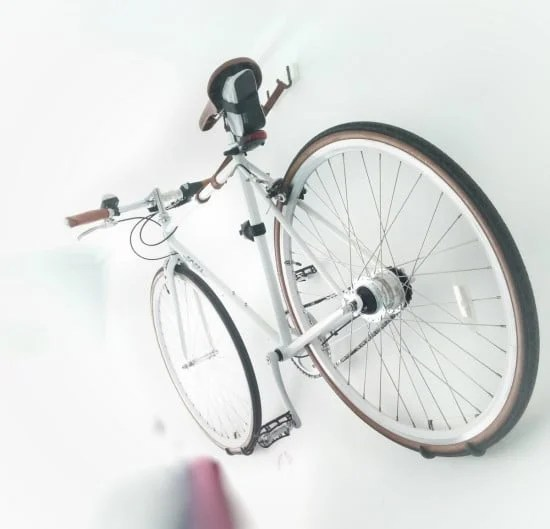 A wall mount bike hanger made from 3 IKEA HJALMAREN towel hangers and a leather strip