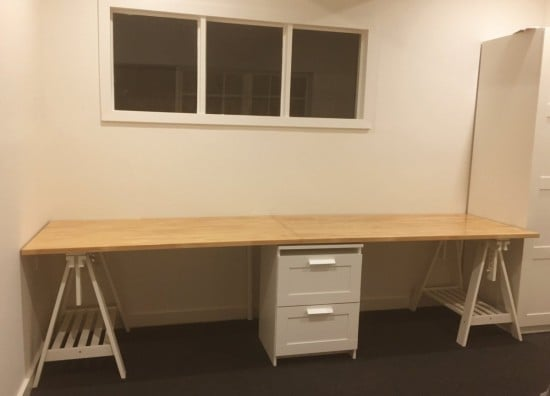 Long wooden home office and study bench desk