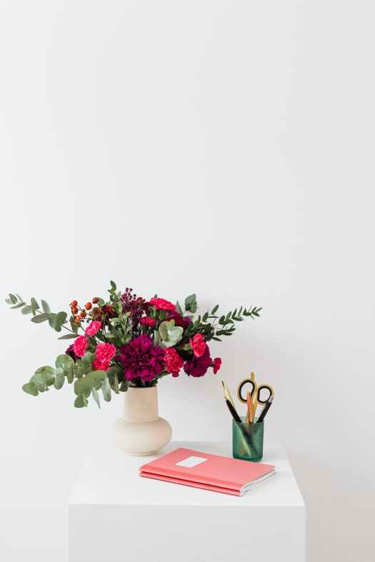 pink and red flowers on white ceramic vase
